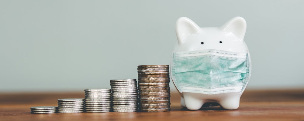 piggybank in surgical mask - cash flow issues related to COVID-19